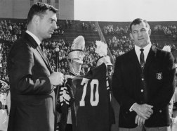 Steelers vice president Dan Rooney holds the retired jersey of Stautner, right, during a ceremony in 1964. (Post-Gazette photo)