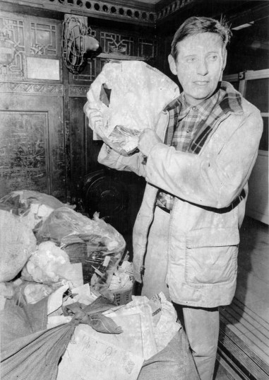 Pittsburgh mayor Peter F. Flaherty carries some garbage into the freight elevator of the City-county building, January 12, 1970 (UPI photo)