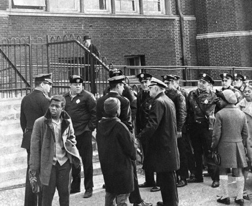 Police gathered outside the school. (Albert Herrmann Jr./The Pittsburgh Press)