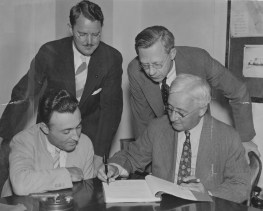 July 11, 1939: A contract for general construction signed by (seated, from left) James Ring, Councilman George E. Evans. Standing, from left: Carroll Hill and Dr. B. J. Hoyde. (The Pittsburgh Press)