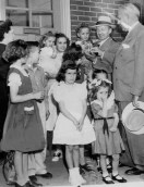 June 11, 1953:Mayor David L. Lawrence hands key of first apartment rented at Bedford Dwellings addition to Andrew Doran. Included are Mrs. Doran and their 10 children. (Credit: Unknown)