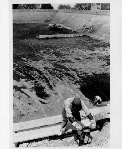 Workers performing repairs at Herron Hill Reservoir in May 1965. (Credit: The Pittsburgh Press)