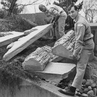 April 2, 1967: George Thorpe, left, Underground Zoo assistant holds the base of a lightweight simulated coral formation while assistant John Raucci lifts one of the simulated reef column structures.