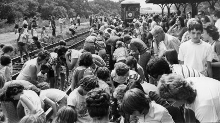 Train buffs placed coins on the track in 1976 before the train arrived in Greensburg. When it left, they bent down to collect the compressed coins as souvenirs. (Albert French/Post-Gazette)