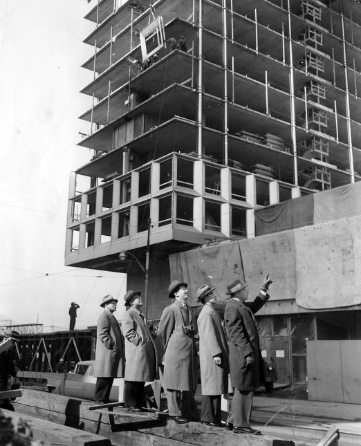 Japanese construction men examined the building in February 1959. (Pittsburgh Press photo)