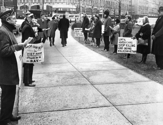 December 29, 1966: A noon standoff near Liberty Ave between members of The Disabled American Veterans Chapter 76 and those in opposition to the war. (Pittsburgh Press photo)