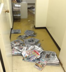 Newspapers were used in an ill-fated attempt at damming the water inside the room where the pipe burst. (Molly Born/Post-Gazette)