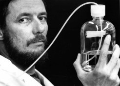 June 30, 1987: Paul Johnson, the director of the PA Center for UFO Research, holds solution used in machine to test soil from UFO landing site.
