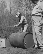 Oct. 23, 1955: An Alcohol Tax Unit agent uses an axe to dump moonshine whisky, which sold for about $1 a pint with no tax. (The Pittsburgh Press)