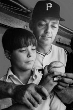 July 30, 1968: Gene Face, seven years older in this photo and able to grip the ball sans fork, practices the forkball with his father. (Harry Coughanour/Post-Gazette)