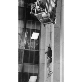 Charles Crane dangles from a safety rope at the Pittsburgh National Bank building. (William Campbell/Post-Gazette)