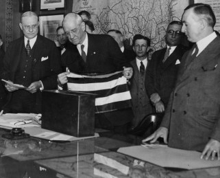 April 15, 1930: An American flag and a Bible were placed inside the cornerstone. County commissioners E.V. Babock, with flag, and Charles C. McGovern, at right. (The Pittsburgh Press)