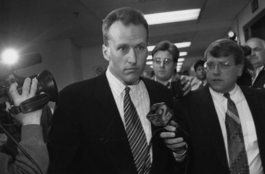 Tom Barrasso steps silent through the midst of reporters outside the Public Safety Building, May 1994, John Heller/Post-Gazette