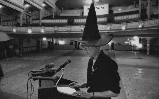 In November 1990, Carol Brown, then head of the Pittsburgh Cultural Trust, wore a witch's hat to a news conference where she announced plans to restore the Fulton Theater. (Tony Tye/Post-Gazette)