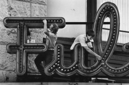 In 1991, Dan Schreiner, left, and Fred Shatzer of Advance Sign Company replaced 550 bulbs in the Fulton Theater marquee. (Robin Rombach/The Pittsburgh Press)