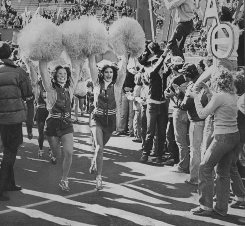 Cheerleaders charge through Pitt Stadium during the Panther's last home game of the season on November 4, 1979. (Edwin Morgan/The Pittsburgh Press)