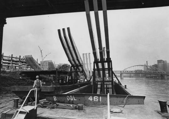 June 17, 1969: A barge load of C frames docks at the confluence of the Allegheny and Ohio rivers near the construction site. (Ross Catanza/The Pittsburgh Press)