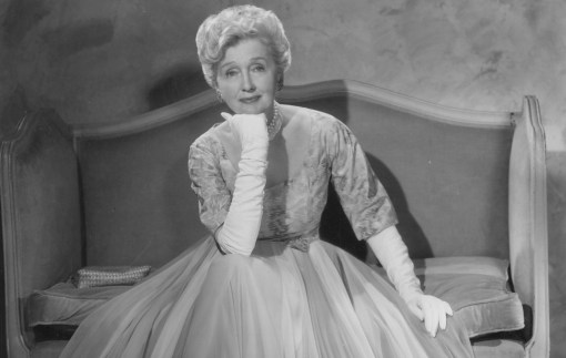 Hollywood gossip columnist Hedda Hopper is shown here in 1961 dressed in an evening gown. (Paul A. Hesse Studios)