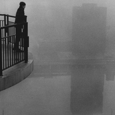Feb. 9, 1970: Marty Molyneux, 16, of Mt. Washington peers out at the fog on the Monongahela River. (Harry Coughanour/Post-Gazette)