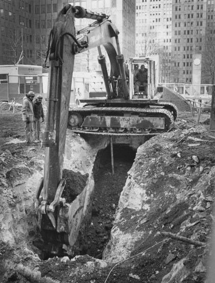 April 12, 1982: Perched precariously over a trench, a backhoe digs during subway construction in Gateway Center. (Robert J. Pavuchak/The Pittsburgh Press)