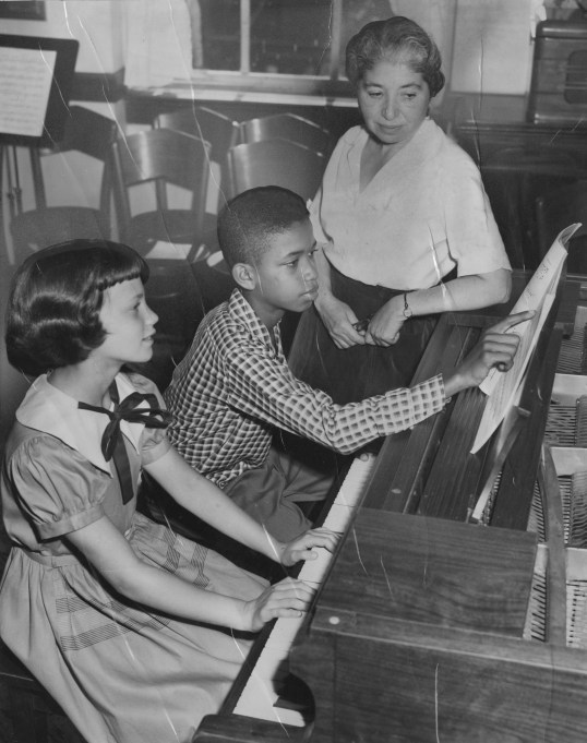 This 1952 photo shows Mrs. Anna Laufe Perlow, in her 30th year as director of the Irene Kaufmann Settlement Music School. At the piano are her pupils, 10-year-old Sue Lindenberg of 1835 Centre Ave. and Julius Hart, 12, of 9 Kearney Way.
