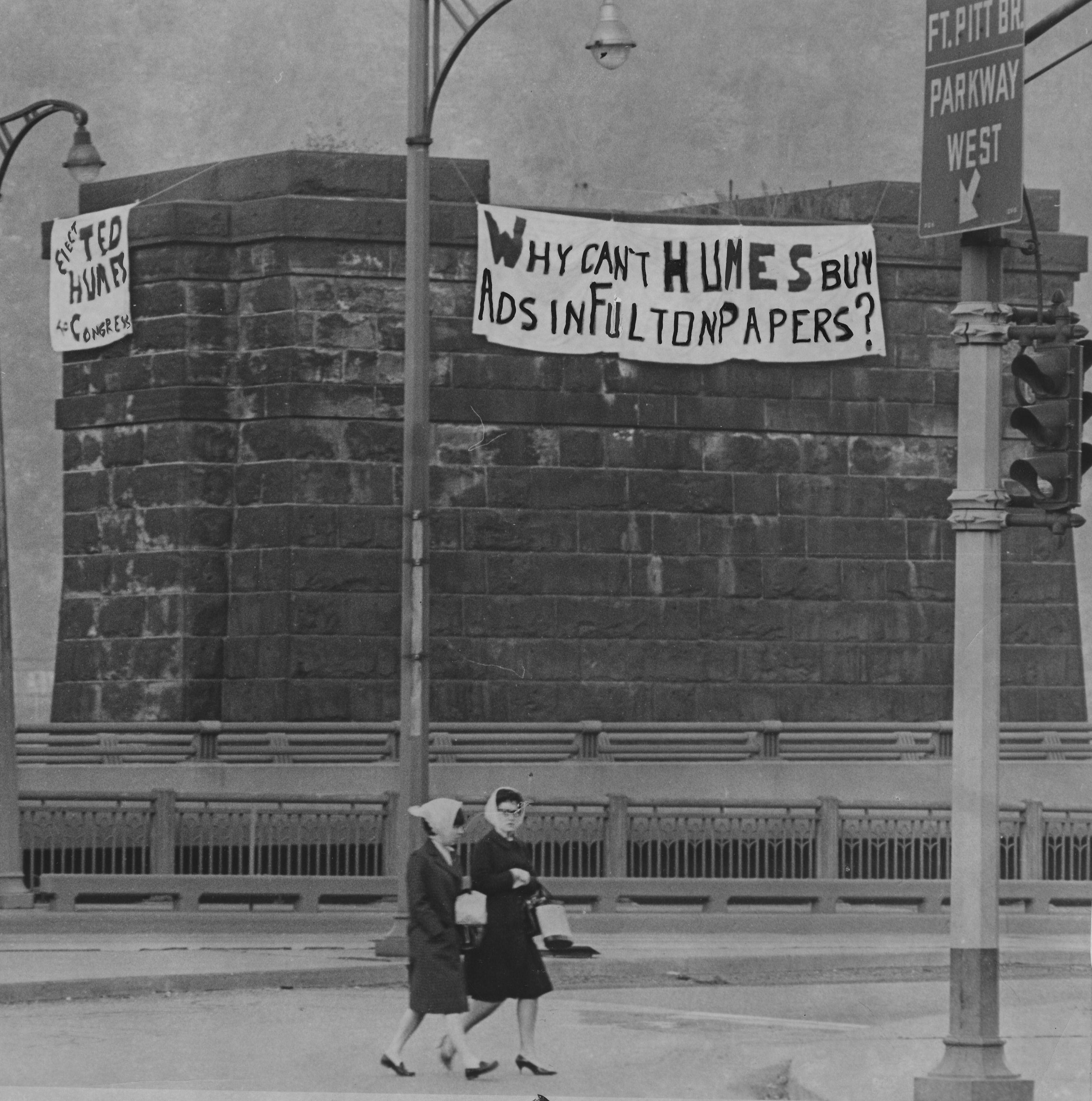 This May 11, 1966 picture shows a large banner hung along a former pier of the Wabash Bridge in the Monongahela River. The outdoor ad referred to Theodore Humes, who sought the Republication nomination in the 27th Congressional District against Rep. James Fulton, who owned the pier. Mr. Humes had alleged that several suburban weekly newspapers Fulton owned refused to accept his political ads.