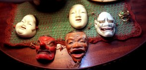 Miniature masks on a table in Margo Lovelace's apartment. (Andy Starnes/Post-Gazette)