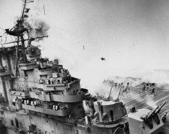 An explosion sends debris flying onto the deck of the Franklin. (US Navy photograph)