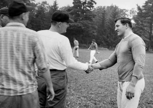 "Steelers coach Buddy Parker greets veteran and future Hall of Famer Ernie Stautner at training camp. The original caption reads, ""Parker is aloof with his players and mostly contacts them through aides."" (Stewart Love/Post-Gazette)"