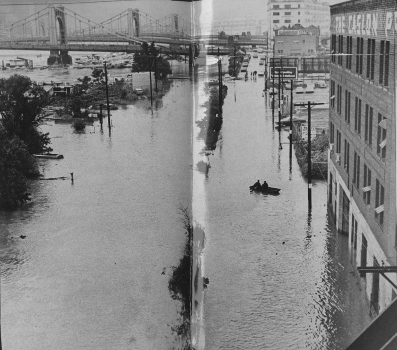 Hurricane Agnes turned River Avenue on the lower North Side into an actual river so that men used a rowboat to maneuver in June of 1972. (Albert M. Herrmann Jr./The Pittsburgh Press)