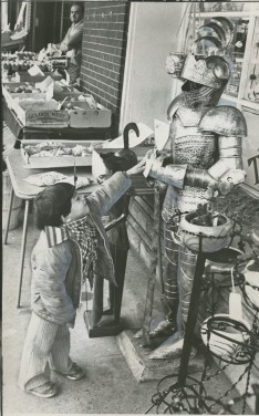 Joey Yankel, 4, investigates a suit of armor at a Strip District shop in 1979. (Edwin Morgan/The Pittsburgh Press)