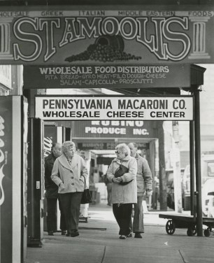 Shops such as Stamoolis and Pennsylvania Macaroni CO. have been staples on the Strip for generations. This photo from March 1987 is similar to the sight shoppers see today. (John Beale/Post Gazette)