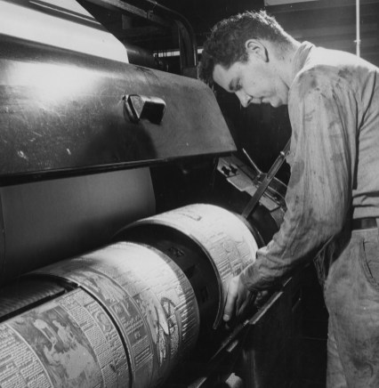 1957: A man loads plates to print news pages at The Pittsburgh Press office.