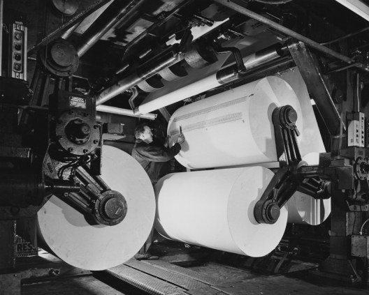 May 27, 1957: An employee of The Pittsburgh Press loads paper for the newspaper's printing run.