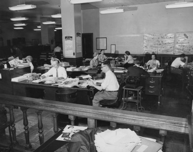 May 27, 1957: A view of the editorial department where employees are working on the women's pages for The Pittsburgh Press.
