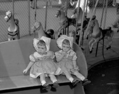 Children wear bonnets on the merry-go-round. (The Pittsburgh Press)