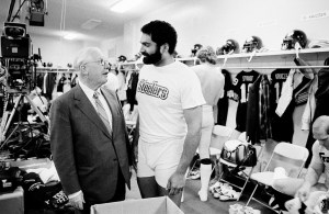 Rooney talks with Steelers running back Franco Harris in the Steelers lockerroom before the start of Super Bowl XIV on Jan. 20, 1980.