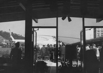 Crowds celebrate the opening of the heliport on the Mon at the foot of Wood Street. (Post-Gazette)