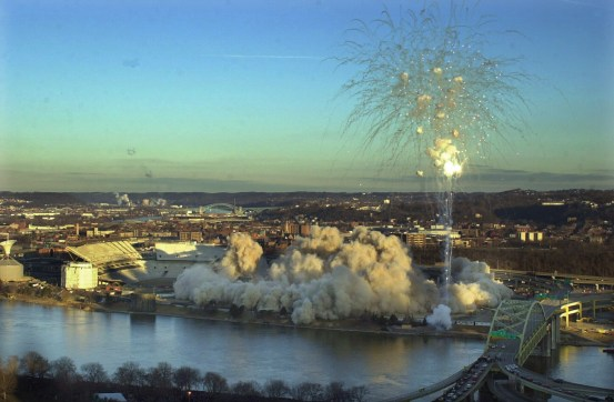 Pittsburgh's Three Rivers Stadium is imploded early Sunday Feb. 11, 2001 in downtown Pittsburgh. At left is the new football only stadium, home to the University of Pittsburgh and Pittsburgh Steelers beginning next season.(AP Photo/Gene J. Puskar)