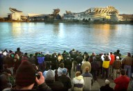 Thousands of spectators crowded into the Point to watch the implosion of Three Rivers Stadium at 8 a.m. on Sunday . At left is Heinz Field under construction. (Steve Mellon/Post-Gazette)