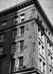 Workmen worked on scaffolding to get the lights set. With 77 days until Christmas, it was one of the earliest decorations to go up in the city and the last to come down. (The Pittsburgh Press)
