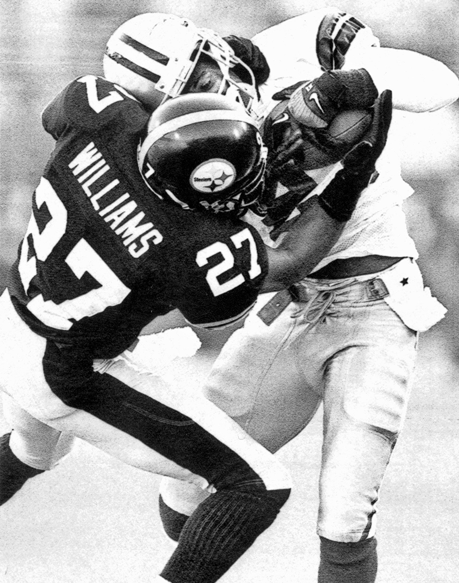 The Cowboys' Deion Sanders wrestles away a first quarter pass from Willie Williams for a Dallas first down in Super Bowl XXX. (Bob Donaldson/Post-Gazette)