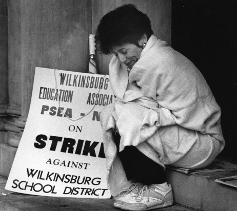 Another teachers strike occurred in the fall of 1991. Teacher Judy Howley kept warm while on the picket line in September of that year. (John Beale/Post-Gazette)