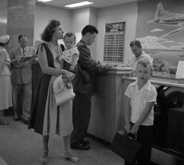 August 1952: One family makes travel arrangements. (Stewart Love/The Pittsburgh Press)