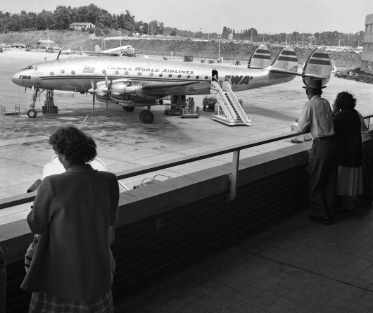 August 1952: From an observation deck, visitors watch planes swoop in and out. (Stewart Love/The Pittsburgh Press)