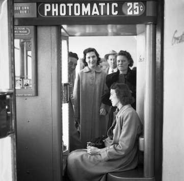August 1952: The photo booth was a popular spot. (Stewart Love/The Pittsburgh Press)