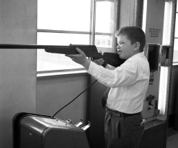 August 1952: At the penny arcade, one young man takes target practice. (Stewart Love/The Pittsburgh Press)