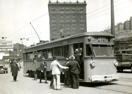 Special trolley car on Liberty Ave, Downtown Pittsburgh, with Penn Station in the background.