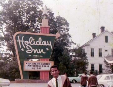 Fernando Balliache in front of Holiday Inn sign, 1965 (Photo courtesy of Fernando Balliache)