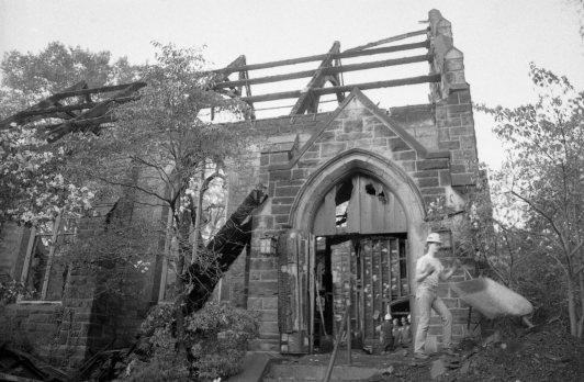 Debris is dumped near a church entrance. (Steve Mellon/The Pittsburgh Press)